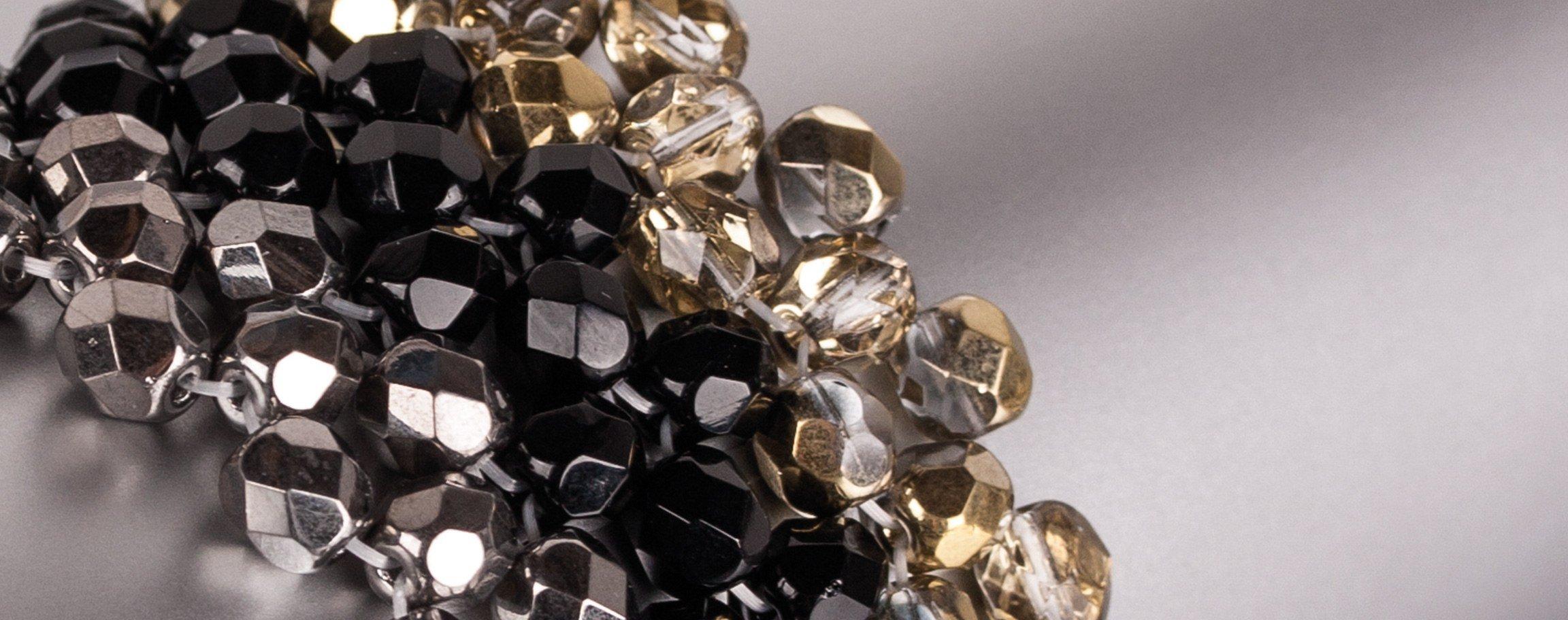 Schwarz-goldfarbenes, breites Armband