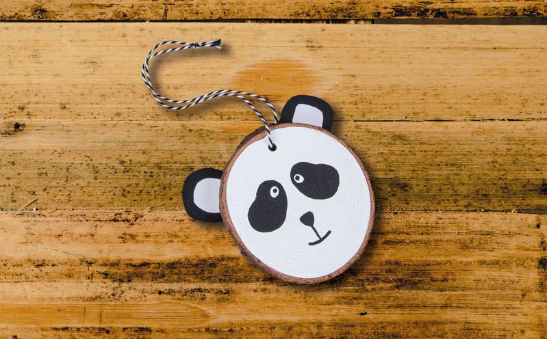Tiergesichter auf Holzscheiben - Panda
